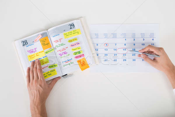Person Hands Highlighting Date On Calendar Stock photo © AndreyPopov