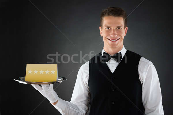 Waiter With Star Rating Board Stock photo © AndreyPopov