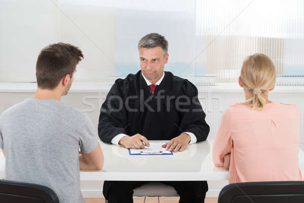 Male Judge Sitting In Front Of Couple Stock photo © AndreyPopov