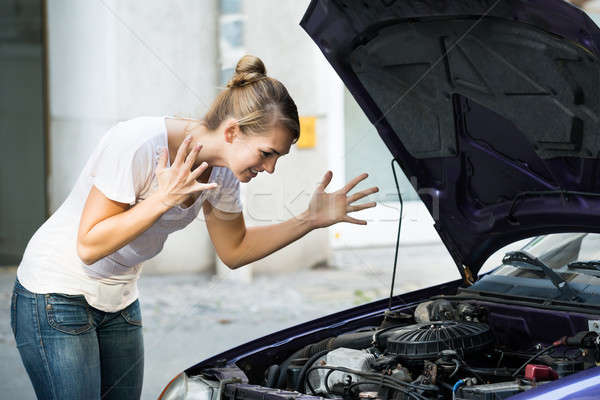 Frustrated Woman Looking At Broken Down Car Engine Stock photo © AndreyPopov