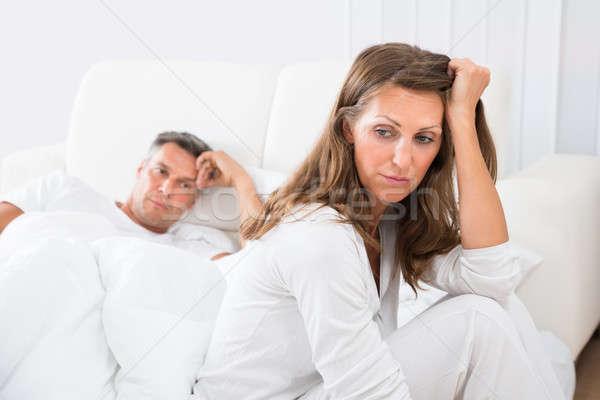 Unhappy Couple In Bedroom Stock photo © AndreyPopov