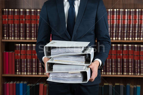 Lawyer Carrying Stack Of Ring Binders Stock photo © AndreyPopov
