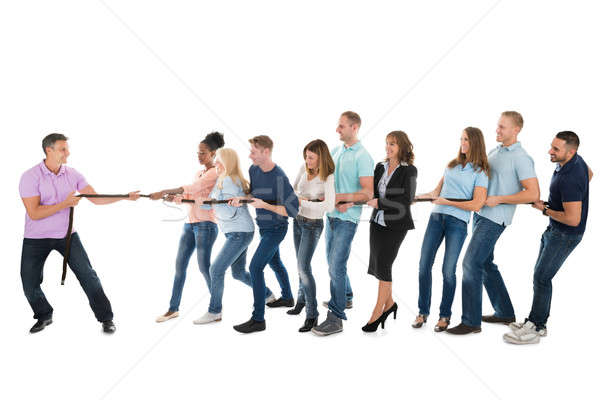 Leader Pulling Creative Business Team While Playing Tug Of War Stock photo © AndreyPopov