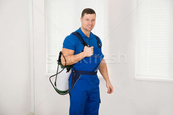 Confident Male Worker Carrying Pesticide Container Stock photo © AndreyPopov