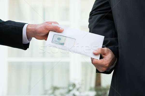 Businessman Receiving Bribe From Partner Stock photo © AndreyPopov
