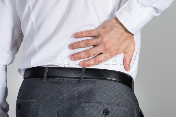Rear View Of Businessman Suffering From Back Ache Stock photo © AndreyPopov