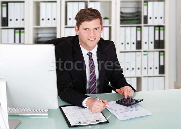 男性 会計士 電卓 デスク オフィス 肖像 ストックフォト © AndreyPopov