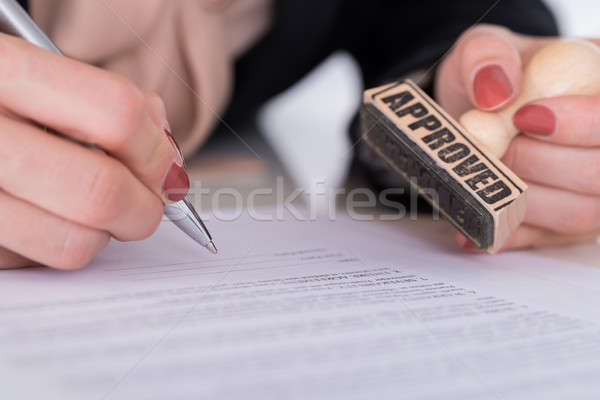 Businessperson Hand With Pen And Stamp Stock photo © AndreyPopov