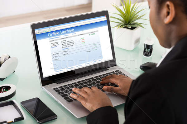 Businesswoman Using Online Banking Service On Laptop Stock photo © AndreyPopov