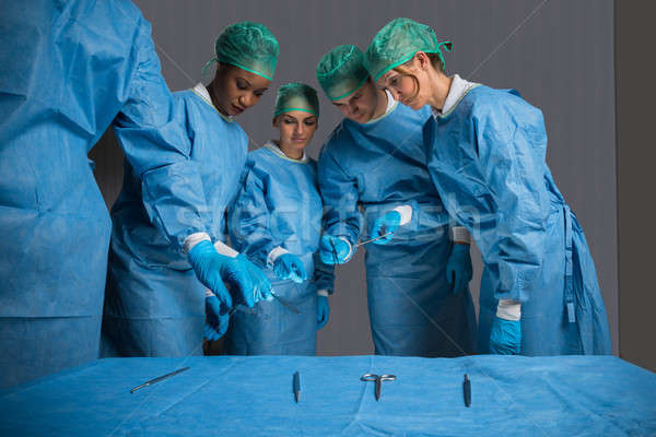 Surgeons In Operating Theater Stock photo © AndreyPopov