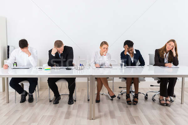 Businesspeople Sitting In A Row Stock photo © AndreyPopov