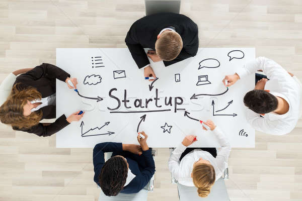 Businesspeople Making Startup Plan Stock photo © AndreyPopov