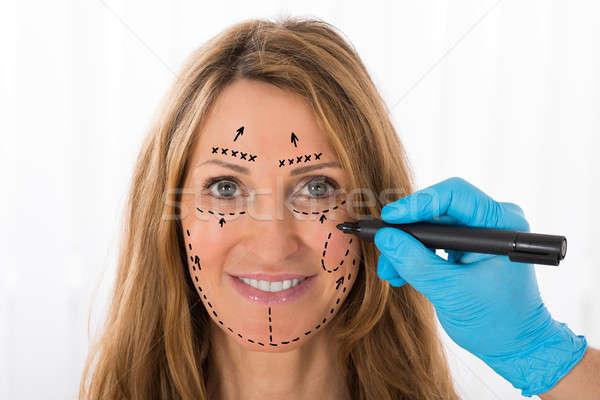 Vrouw perforatie lijnen gezicht gelukkig Stockfoto © AndreyPopov