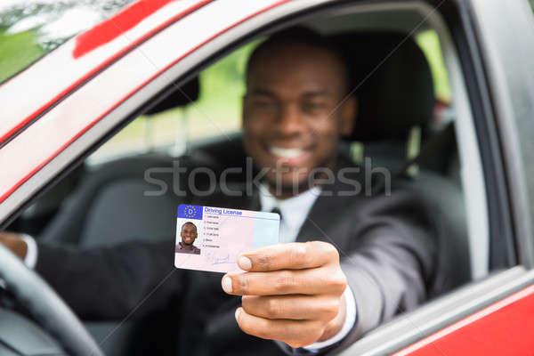 üzletember mutat vezetés licenc nyitva autó Stock fotó © AndreyPopov
