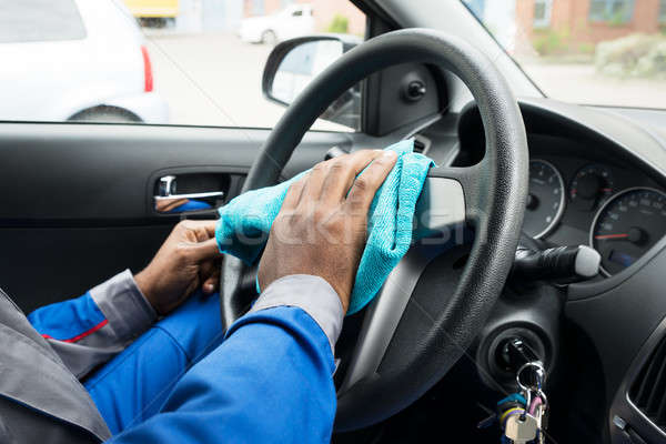 Munkás takarítás autó kormánykerék közelkép férfi Stock fotó © AndreyPopov