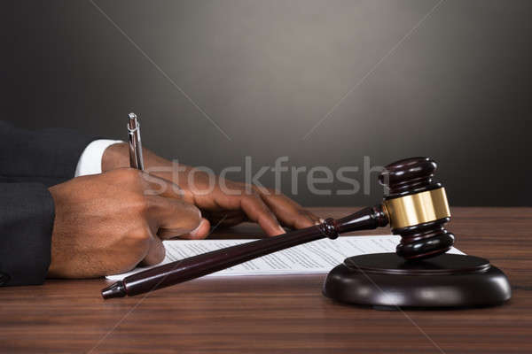 Close-up Of A Judge Writing On Paper Stock photo © AndreyPopov
