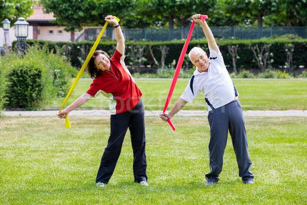 Senior Couple Exercising With Yoga Belt Stock photo © AndreyPopov
