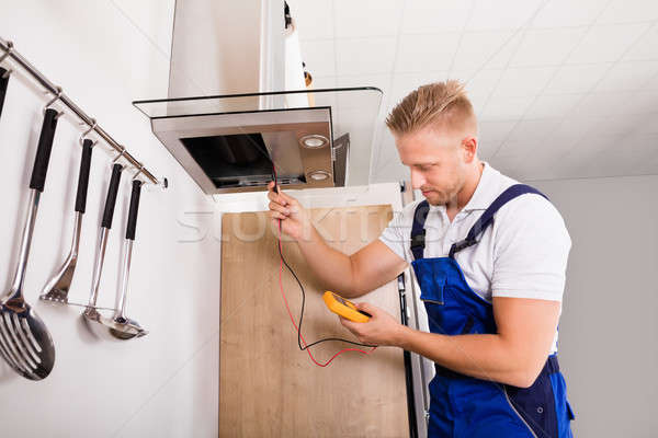 Technician Checking Kitchen Extractor Filter Stock photo © AndreyPopov