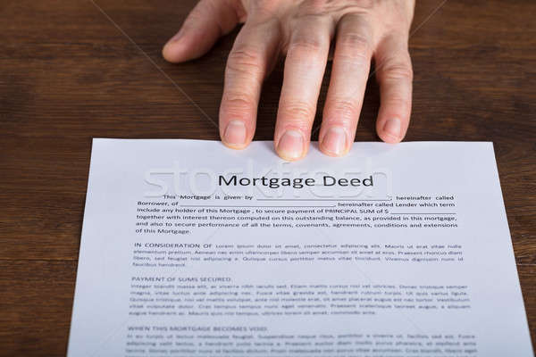 Stock photo: Person Hand Presents A Mortgage Document