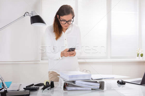 Woman Capturing Documents On Mobile Phone Stock photo © AndreyPopov