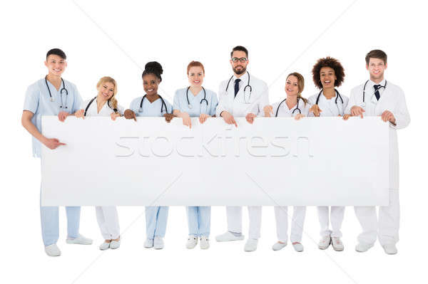 Group Of Medical Team Holding Blank Billboard Stock photo © AndreyPopov