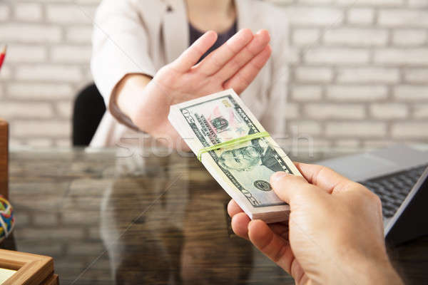 Businesswoman Refusing To Take Bribe From Partner Stock photo © AndreyPopov