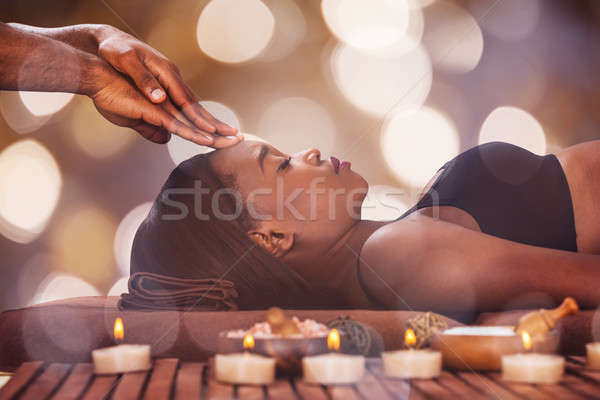 Woman Receiving Forehead Massage Stock photo © AndreyPopov