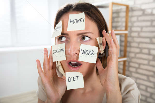 Woman With Sticky Notes On Her Face Stock photo © AndreyPopov