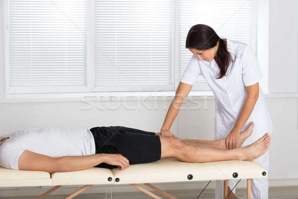 Physiotherapist Massaging Man's Leg Stock photo © AndreyPopov