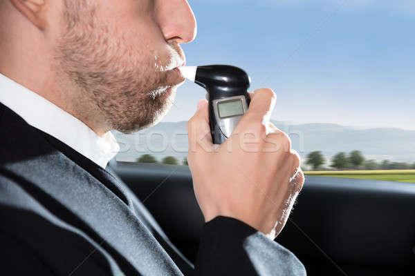Człowiek alkoholu test posiedzenia Zdjęcia stock © AndreyPopov