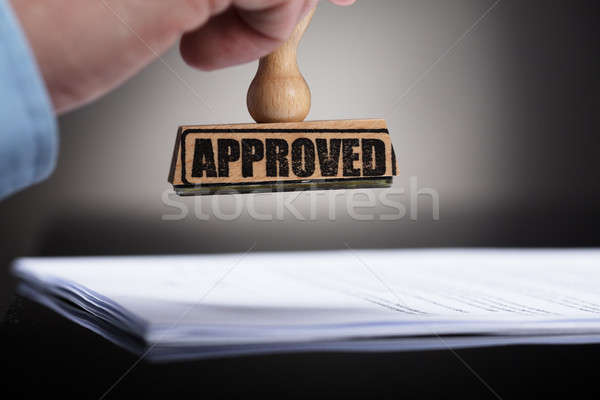 Businessperson Stamping On Approved Contract Form Stock photo © AndreyPopov