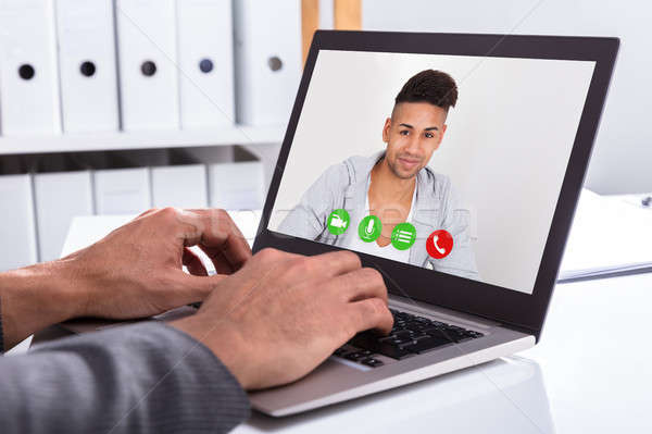 Businessperson Video Conferencing With Male Friend On Laptop Stock photo © AndreyPopov