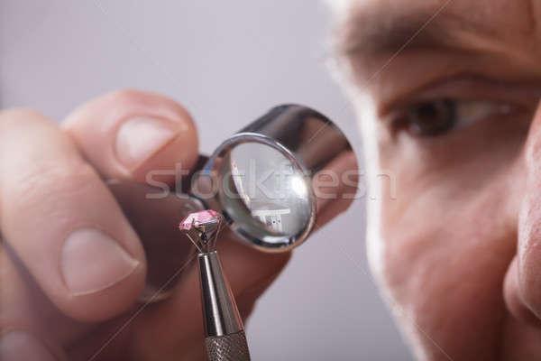 Person Checking Diamond Through Magnifying Loupe Stock photo © AndreyPopov