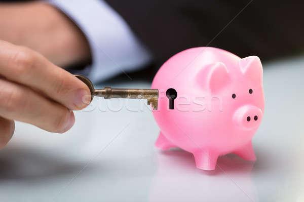 Kişi anahtar bankalar anahtar deliği Stok fotoğraf © AndreyPopov