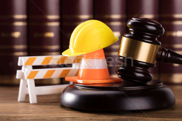 Stock photo: Mallet With Road Barrier, Hard Hat And Traffic Cone In Courtroom