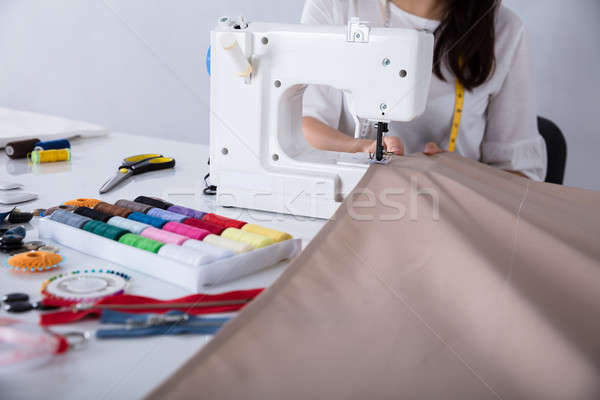 Fashion Designer Stitching Cloth On Sewing Machine Stock photo © AndreyPopov