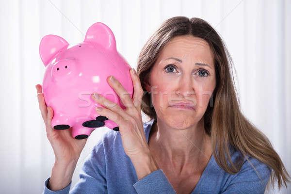 Ongelukkig vrouw spaarpot bank Stockfoto © AndreyPopov