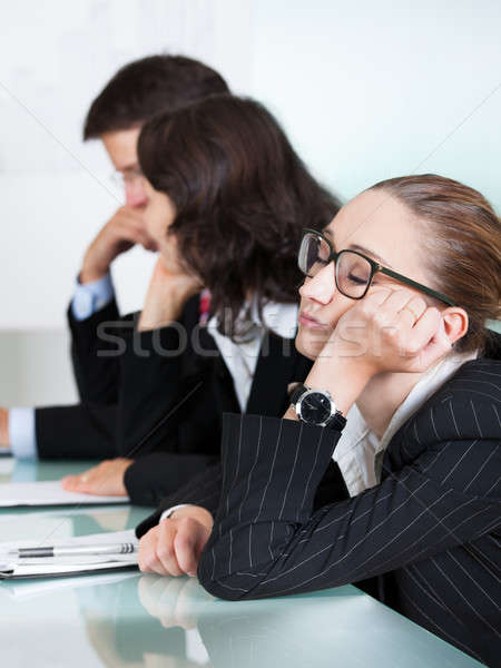 Bored businesswoman sleeping in a meeting Stock photo © AndreyPopov