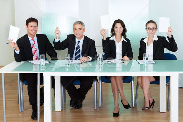 Group of judges holding up blank cards Stock photo © AndreyPopov