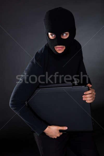 Burglar on Computer Stock photo © AndreyPopov