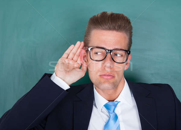 Male Professor Trying To Hear Stock photo © AndreyPopov