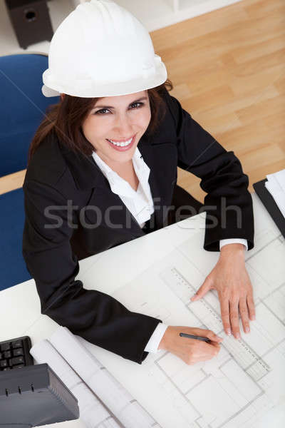 Businesswoman In Hardhat With Blueprints Stock photo © AndreyPopov