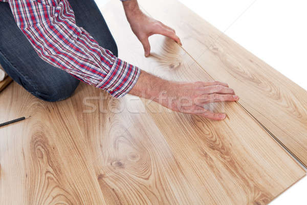 Worker assembling laminate floor Stock photo © AndreyPopov