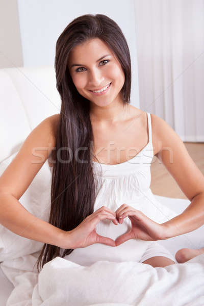 Pregnant woman making a heart sign Stock photo © AndreyPopov