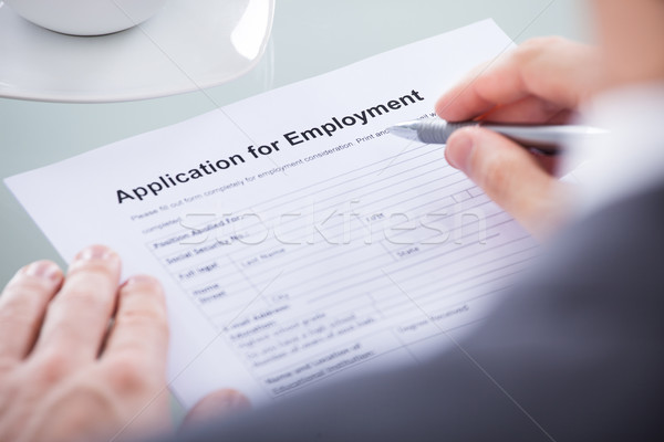 Stock photo: Businessperson With Pen Over Application Form