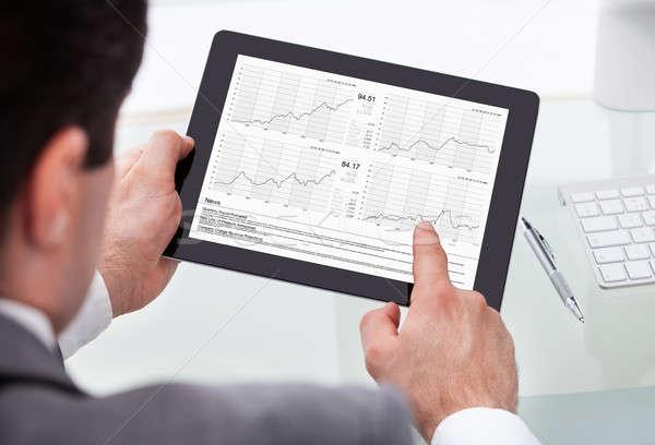 Businessman Analyzing Stock Market Status On Digital Tablet Stock photo © AndreyPopov