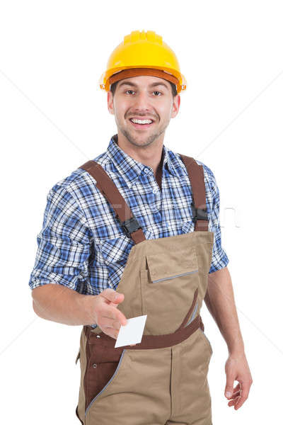 Stock photo: Confident Young Manual Worker Giving Visiting Card