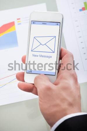 женщину обмен сообщениями смартфон дома женщины Сток-фото © AndreyPopov