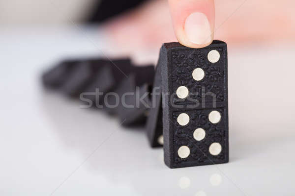Woman's Hand Playing Domino Stock photo © AndreyPopov