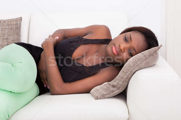 Woman Suffering From Stomachache At Home Stock photo © AndreyPopov